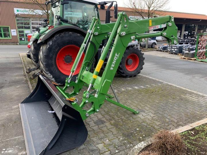 A used front loader by John Deere.